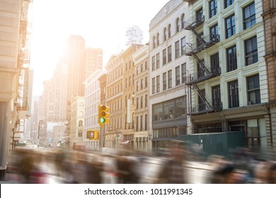 Fast paced motion blur of people walking down Broadway in SoHo Manhattan, New York City