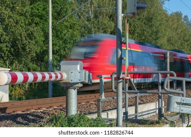 Fast passenger train passes the barrier
