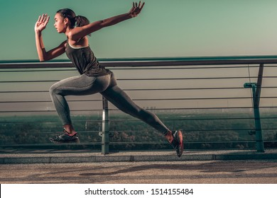 Fast professional athlete running at high speed on the bridge