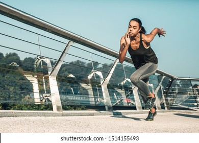 Fast professional runner moving at high speed outdoors on the bridge. Template banner
