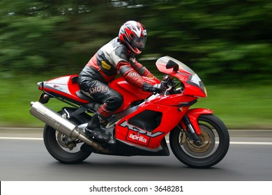 Fast red Italian Motorcycle at speed