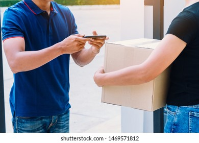 Fast and reliable service. Delivery man sent parcel for customer at house. Customer signing in tablet after recive parcel
