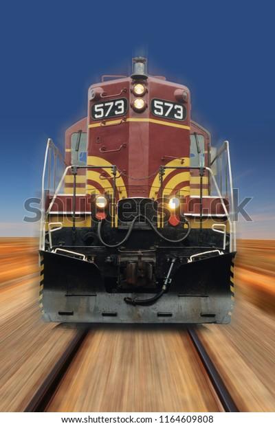 fast running diesel locomotive in the desert