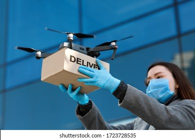 Fast and safe delivery. Drone delivering brown post package to woman doctor, coronavirus, quarantine, contactless delivery