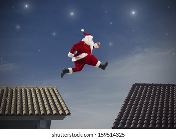 Fast Santa Claus jumping on a roof