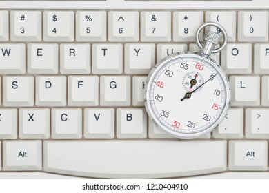 Fast search times on the  Internet, A close-up of a keyboard with stopwatch