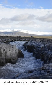 Fast stream of the Hvita river by road F550 near Langjokull glacier in the highlands of Iceland
