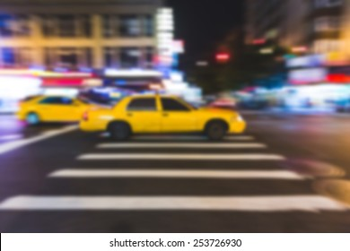 Fast Taxy Running on the Street. Blurred Background.