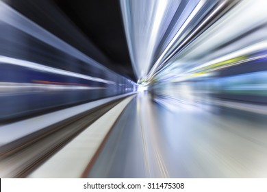 fast train traveling at high speed through a station
