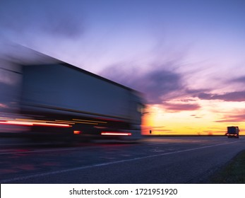 fast truck on the highway in sunset time and in long exposure for increasing speed of moving it under sky with copy space