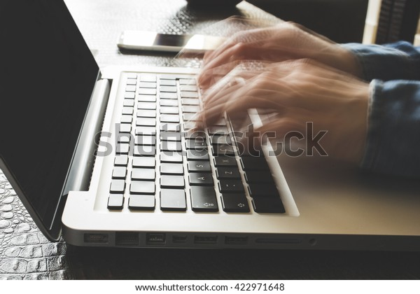 Fast typing woman on laptop. Blurred hands typing