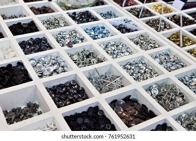 Fasteners and fittings for furniture in sections
