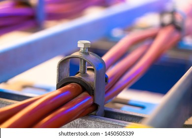 Fasteners for wiring. Cable clamp. Wiring. Wire fasteners. Clamps of the electric cable. Device for fixing the electric wires. Cable clamping fixture.