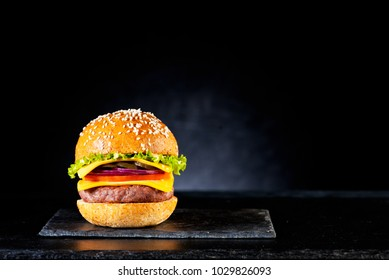 Fastfood burger cheeseburger with cutlet, cheese and vegetables