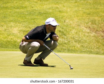 FASTH, NICLAS - NOVEMBER 17: Professional Golfer Playing at Gary Player Charity Invitational Golf Tournament  November  17, 2013, Sun City, South Africa. Niclas finding the best putting line.