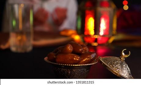 Fasting during Ramadan. Breaking the fast. Religious muslim man praying