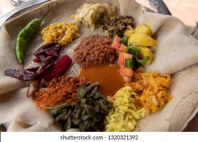 Fasting Enjera, or traditional Ethiopian and Eritrean dish made with teff flour. During fasting days it is eaten with vegetables