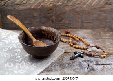 Fasting, Lent. Cup and cross.