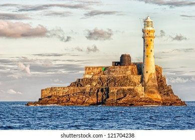 Fastnet Lighthouse, a mall islet in the Atlantic Ocean and the most southerly point of Ireland, at sunset