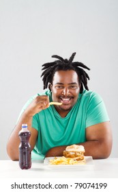 fat african american man eating chips