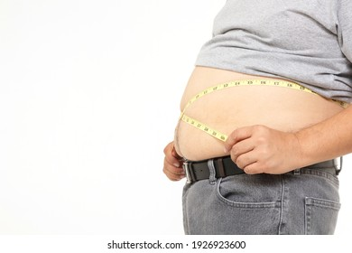 Fat Asian men use a yellow tape measure. Measure your belly size. Concept of weight loss, health problems of obese people. White background. isolated. Copy space