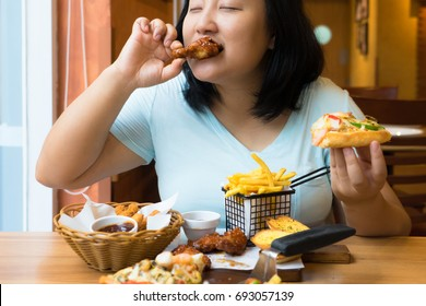 fat asian woman is enjoy eating fastfood,big meal,overweight female
