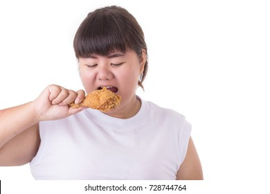 Fat asian woman holding and eating fried chicken isolated on white background. food and healthcare concept