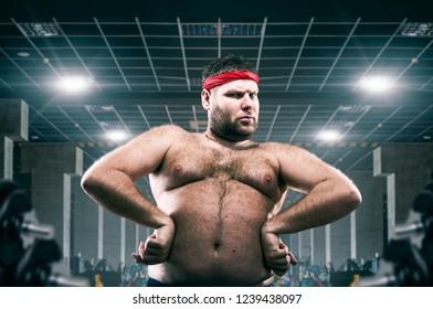 Fat athlete on workout in fitness club, fatness