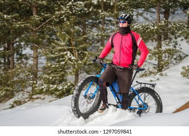Fat bike rider in winter. Cycling.