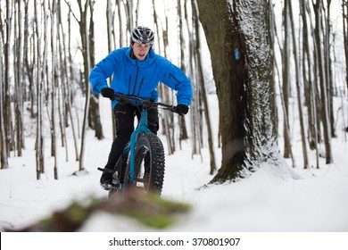 Fat biker riding his bicycle in the snow during Canadian winter