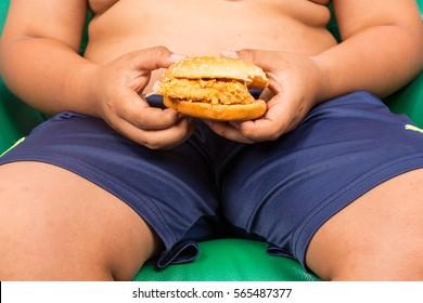 Fat Boy eating hamburger,junk food