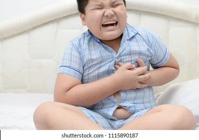 Fat boy with heart attack, pain in chest, overweight child body, Health care concept