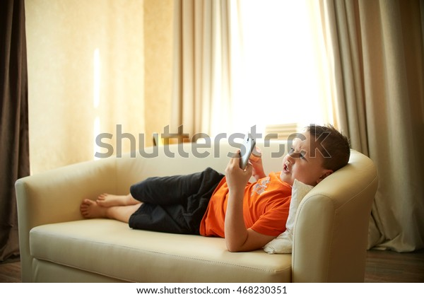 Fat Boy Lying On Couch Playing Stock Photo Edit Now 468230351