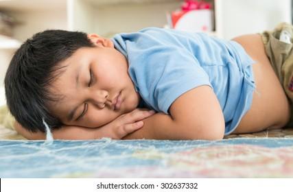 Fat boy sleep dream on his arm.