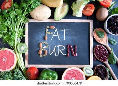 Fat burn on a chalkboard surrounded by fresh detox food ingredients