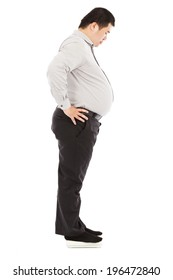 fat business man standing on weight scale
