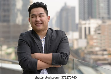 Fat businessman smiling