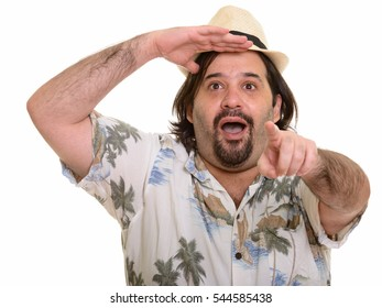 Fat Caucasian man looking amazed and pointing finger at distance isolated against white background
