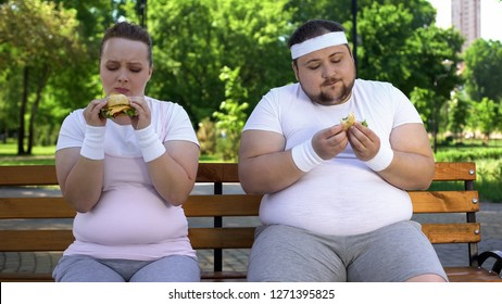 Fat couple eating burgers, feeling guilty for stopping diet, fast food addicted