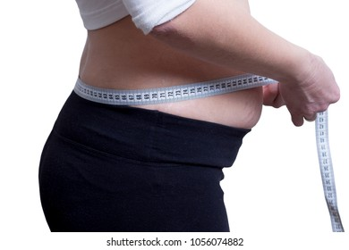fat girl measures the size of waist. concept of losing weight. Watch figure. Measuring tape around the waist. A young girl plus size measures her hips. To go on diet. Healthy lifestyle. Look good
