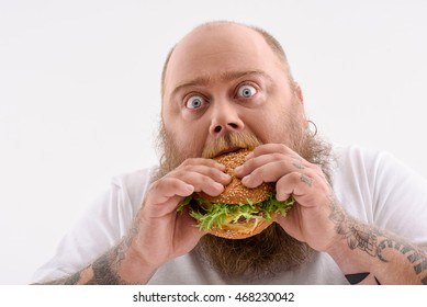 Fat guy eating unhealthy food