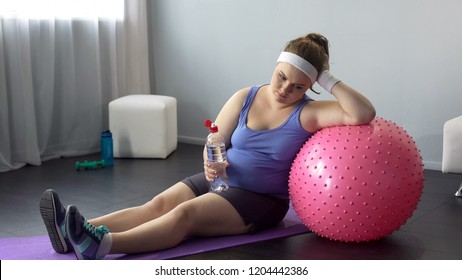 Fat lady depressed about her weight unsuccessful workout restoring water balance