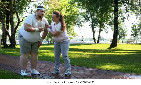 Fat male feels heart pain while jogging, obese girl helping him, friends support