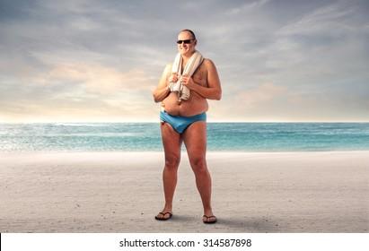 Fat man at the beach