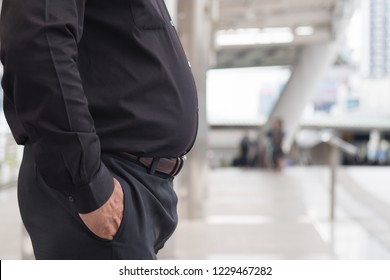 fat man belly. close up shot of fat, obese, overweight dad bod stomach. southeast asian man model