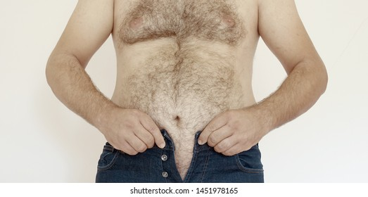 Fat man body trying to put on his tight jeans  Big male belly, obesity lifestyle - Obesty concept