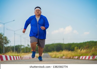 Fat man, he is jogging To lose weight