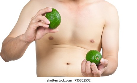 Fat man holding avocado for diet isolated on white background.