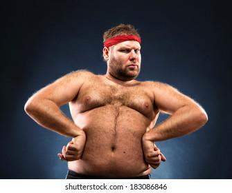 Fat man imitating muscular build