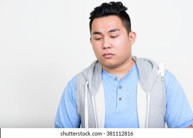 Fat man looking down